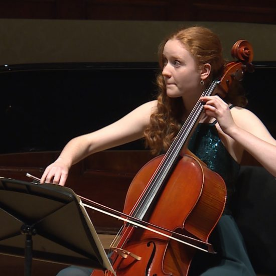 girl in formal dress playing cello