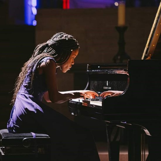 teenage girl performing piano